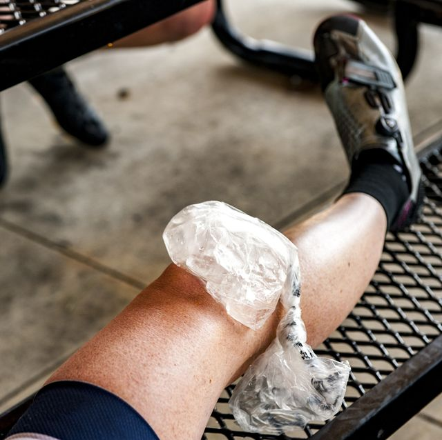 ice pack on woman cyclist's knee