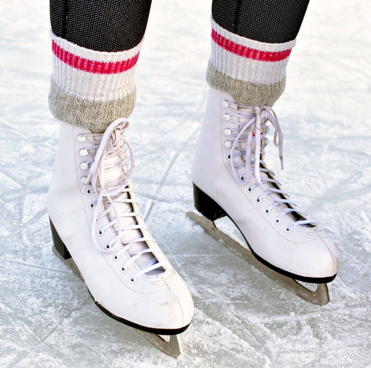 ice skates with red and white striped socks