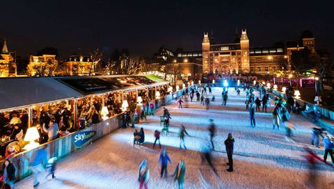 Ice rink, Ice skating, Skating, Night, Recreation, Ice, Building, Winter, Winter sport, Leisure,