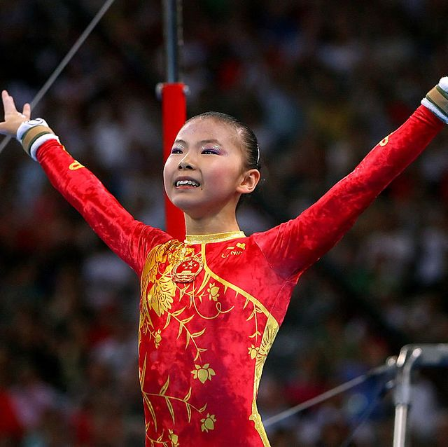 beijing   august 13  he kexin of china reacts after competing in the uneven bars during the artistic gymnastics team event at the national indoor stadium during day 5 of the beijing 2008 olympic games on august 13, 2008 in beijing, china  photo by al bellogetty images