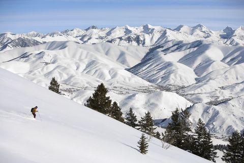 usa, idaho, sun valley, man downhill skiing, side view