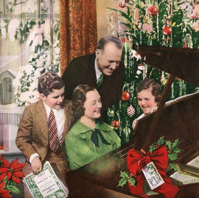 family gathered around piano