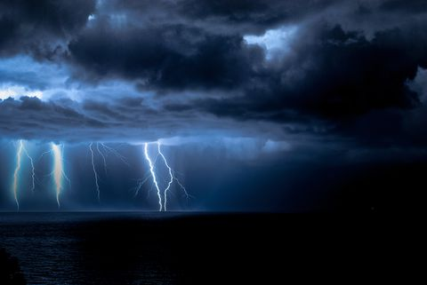 Idyllic Shot Of Lightning Over Sea