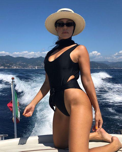 One-piece swimsuit, Clothing, Monokini, Swimwear, Maillot, Leg, Thigh, Sun tanning, Summer, Model,