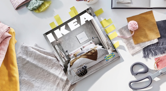 ikea catalog 2021 bookmarked and surrounded by fabric swatches