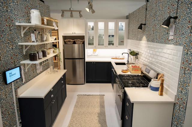 kitchen set in ikea queens, white subway tile, lights, silver fridge black cabinet, white shelves
