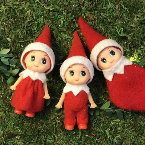 lawn ornament, red, christmas, christmas ornament, toy, santa claus, fictional character, statue, garden gnome, grass,