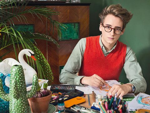 Eyewear, Glasses, Vision care, Writing implement, Sweater, Stationery, Office supplies, Television, Houseplant, Shelf,