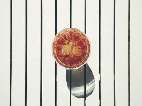 Amber, Coin, Metal, Parallel, Bronze, Maroon, Copper, Analog watch, Still life photography, Currency,