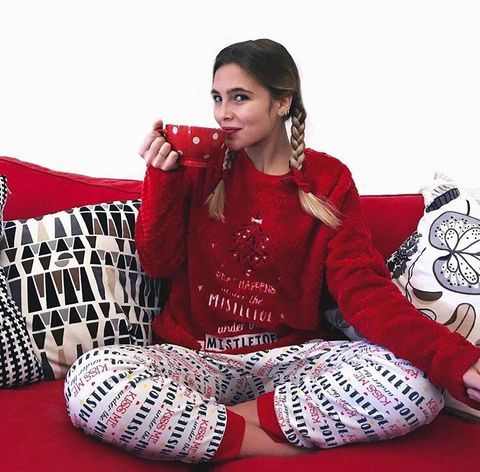 Red, Clothing, Maroon, Sitting, Sleeve, Photo shoot, Pajamas, Design, Pattern, Outerwear,