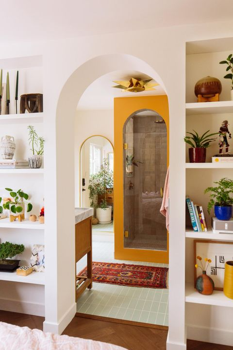 remodeled bathroom with yellow arched shower door