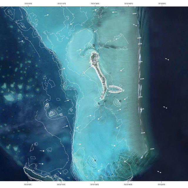 a satellite image of the maldives, where researchers are rebuilding islands and sandbars
