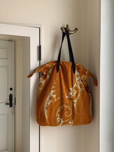 Brown, Door, Bag, Home door, Tan, Shoulder bag, Luggage and bags, Fashion accessory, Fixture, Orange,