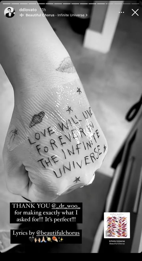 demi lovato hand tattoo