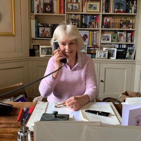 camilla making a phone call from her desk