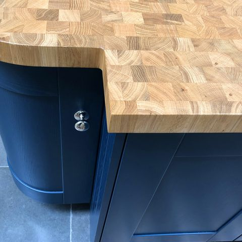 Image of modern blue kitchen curved floor cabinet cupboard with real wood worktop