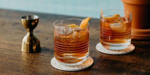 Drink, Liqueur, Old fashioned glass, Glass, Drinkware, Old fashioned, Distilled beverage, Still life, Shot glass,