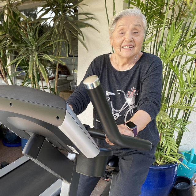 ki hong exercising on a stationary bike
