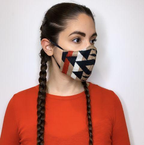 indigenous fashion designer korina emmerich models one of her masks