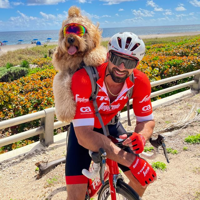 brodie the bike riding goldendoodle and his owner cliff out on a ride