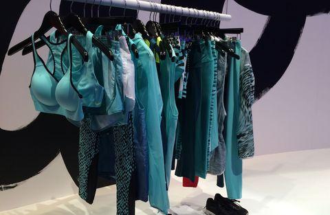 Clothes hanger, Teal, Fashion, Aqua, Fashion design, Collection, Boutique, Retail, Outlet store,