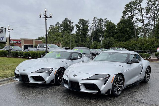 two silver 2021 toyota supras