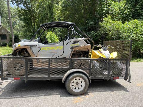 Polaris rzr trail and honda 250x atv in utility trailer