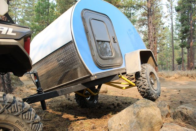 the boony stomper off road trailer on rocks