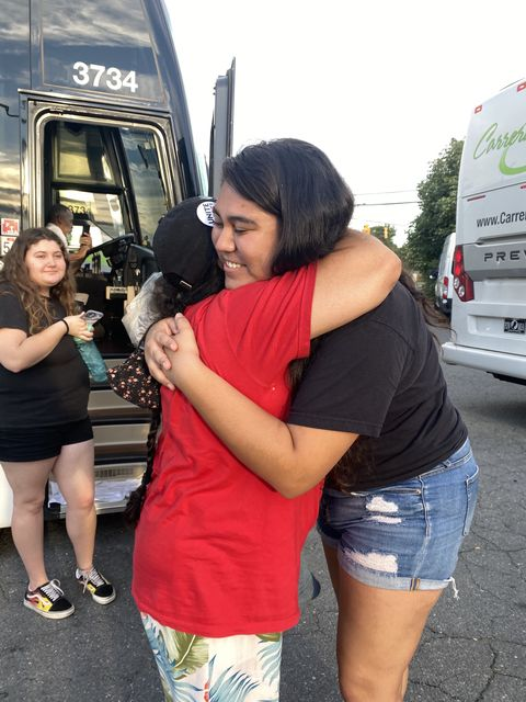 marisela gives a hug before getting on the bus