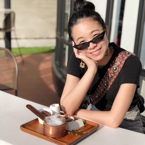 Eyewear, Beauty, Arm, Glasses, Hand, Vision care, Sitting, Fashion design, Fashion accessory, Table,