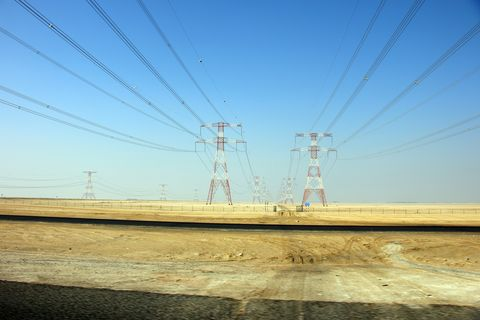 Overhead power line, Sky, Electricity, Transmission tower, Line, Electrical supply, Yellow, Transport, Horizon, Road,