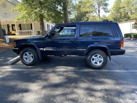 a blue xj jeep cherokee
