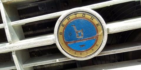 Motor vehicle, Car, Vehicle, Emblem, Fashion accessory, Grille, Auto part, Logo, Antique car,