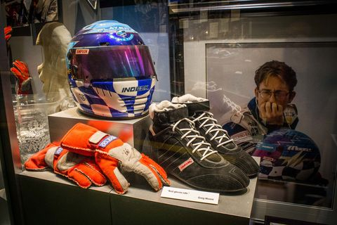 Helmet, Motorcycle helmet, Personal protective equipment, Display case, Sports gear, Headgear, Automotive design, Space, Sports equipment, Collection,
