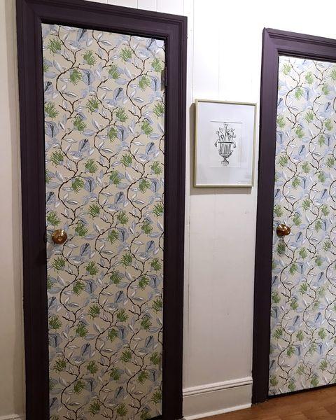 two closet door with floral wallpaper