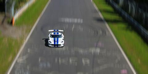 Race track, Vehicle, Sports car racing, Lane, Race car, Mode of transport, Endurance racing (motorsport), Car, Auto racing, Motorsport,