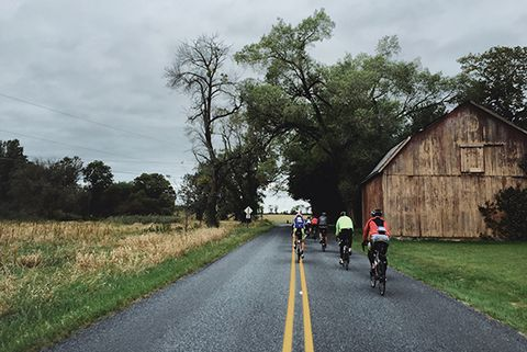 Bicycling Fall Classic cyclists ride past an old barn in the Lehigh Valley.