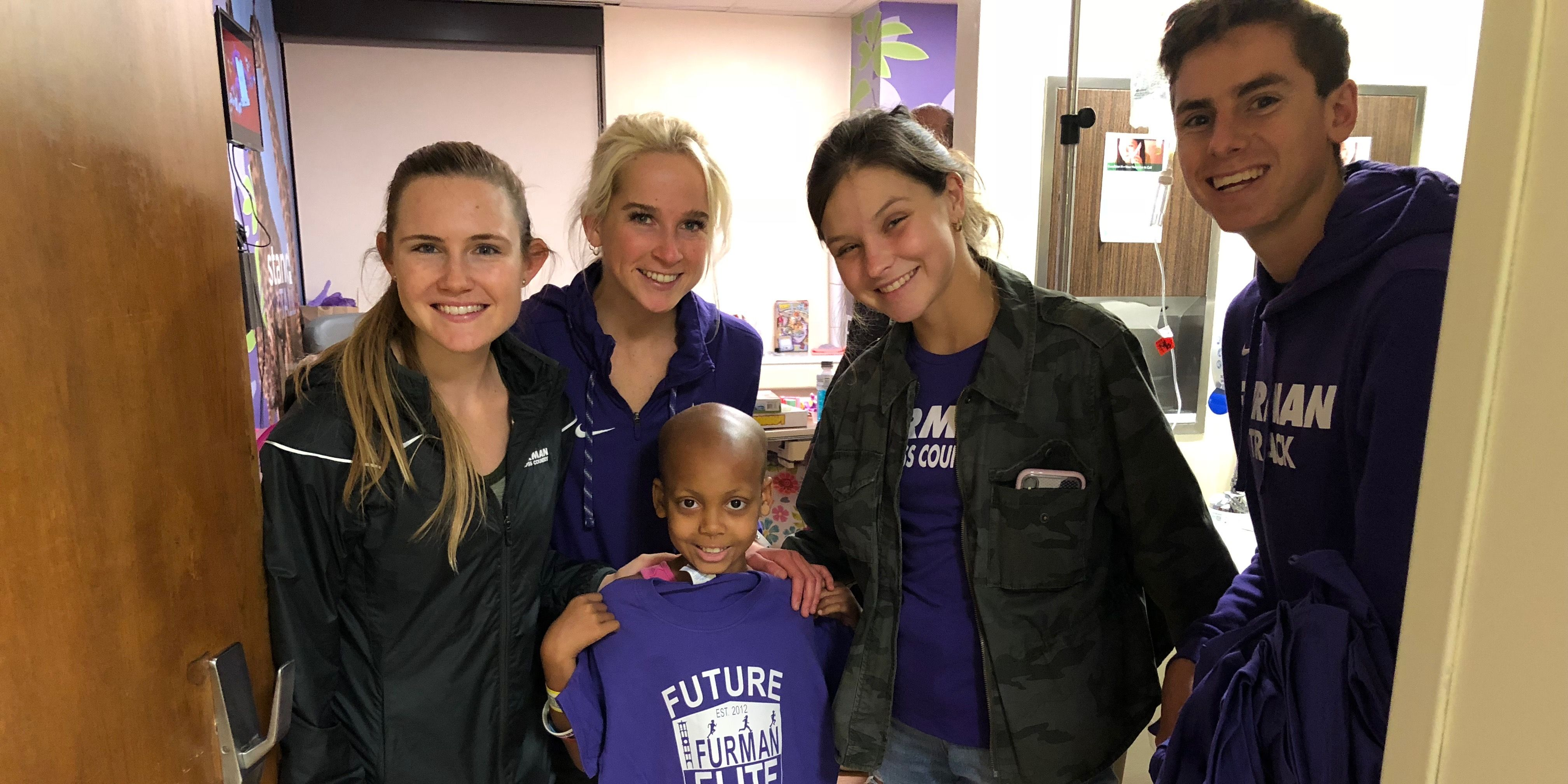 Furman cross country visits hospital