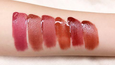 Lip, Lipstick, Skin, Beauty, Cosmetics, Lip gloss, Orange, Pink, Close-up, Gloss,