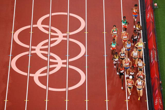 tokyo, japan   july 30 competitors in heat 1 of the womens 5000m round 1 run past the olympic rings on day seven of the tokyo 2020 olympic games at olympic stadium on july 30, 2021 in tokyo, japan photo by richard heathcotegetty images