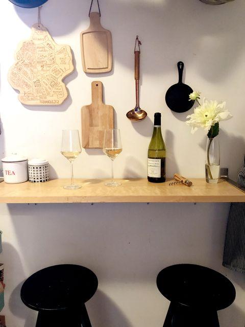 Bottle, Glass bottle, Wine bottle, Drink, Interior design, Shelving, Stool, Home accessories, Collection, Earrings,