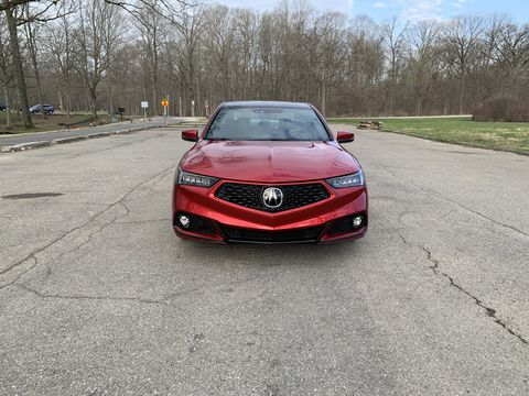 the 2020 acura tlx pmc edition out on country roads during an early michigan spring day