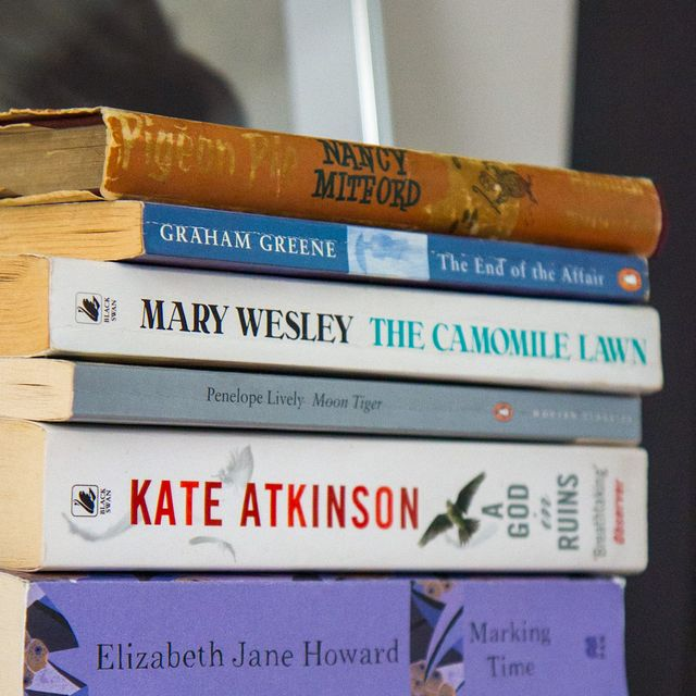 selection of paperback wartime novels in a pile
