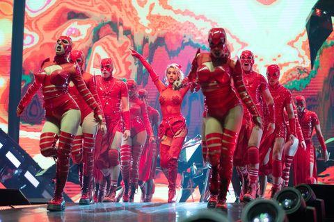 Red, Performance, Event, Performance art, Fictional character, Performing arts, Flesh, Team, Superhero, Dancer,
