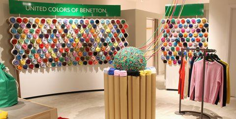 Interior design, Room, Textile, Furniture, Boutique, Art, Visual arts, Flooring, Modern art,