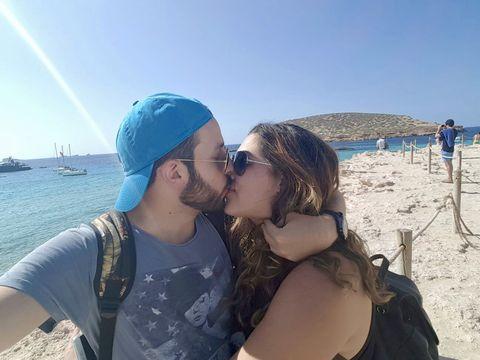 Giuseppe and Rachel kissing.