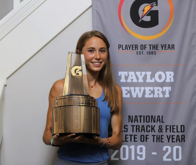 taylor ewert holds her gatorade player of the year award after being surprised at home with the trophy