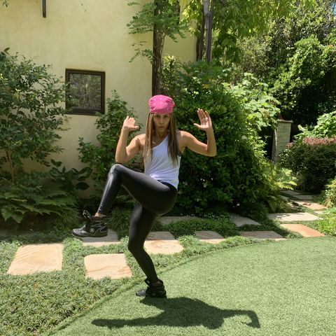 halle berry doing an exercise move in her backyard