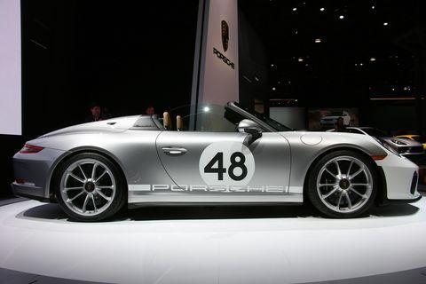 Land vehicle, Vehicle, Car, Sports car, Auto show, Convertible, Supercar, Automotive design, Porsche, Performance car,