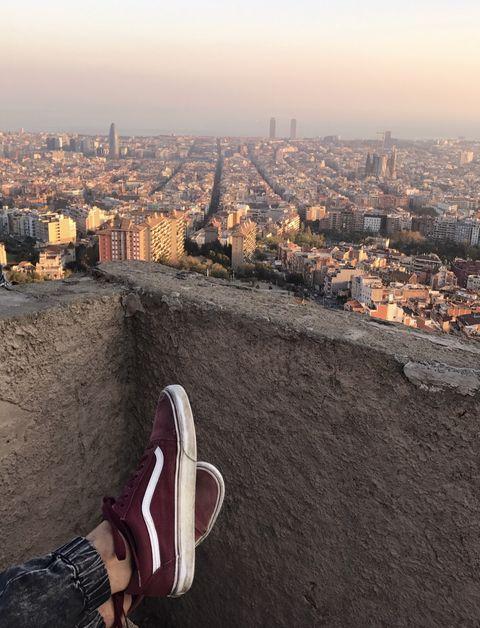 Sky, Footwear, Urban area, City, Human settlement, Mountain, Cityscape, Morning, Shoe, Tourism,